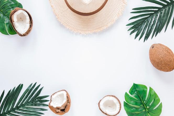 Frame of palm leaves, coconuts and straw hat