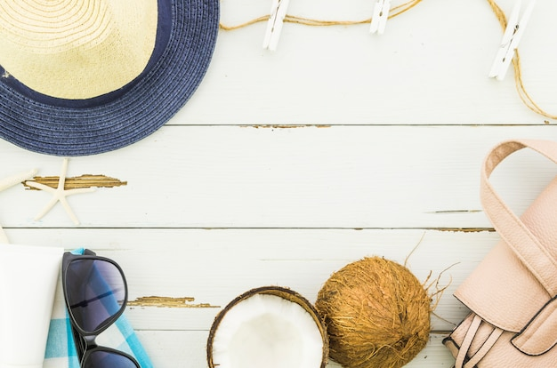 Frame of panama hat, sunglasses and coconut