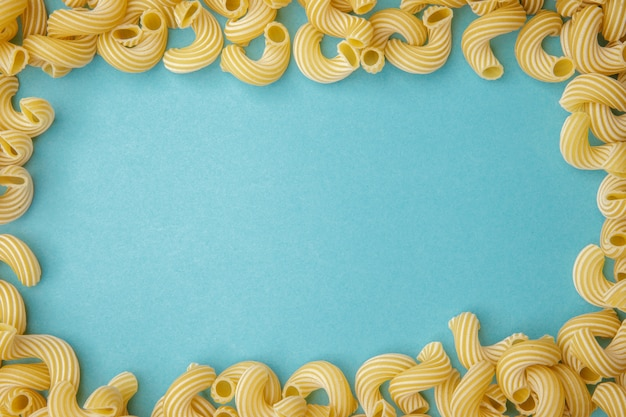 Frame of the pasta on blue table