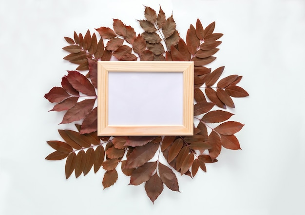 Frame for photos in autumn leaves isolated