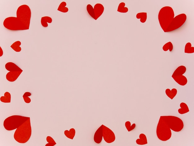 Frame of red heart on pink backgrond with copyspace for valentine greeting card.