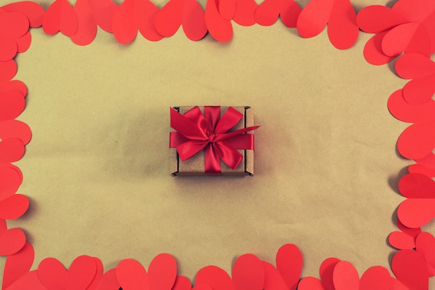 Frame of red hearts packaging with a gift concept of valentine's day