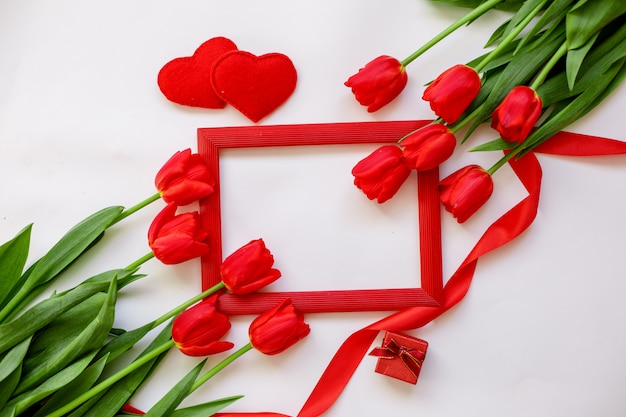 Frame and red tulips background isolated on white background. space for text. concept of valentine's day, international women's day