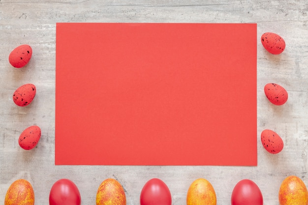Frame of red and yellow eggs for easter