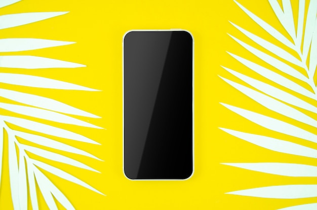 Frame smartphone with blank screen on yellow background