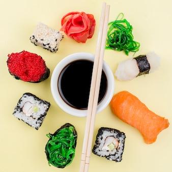 Frame of sushi around soya souce bowl