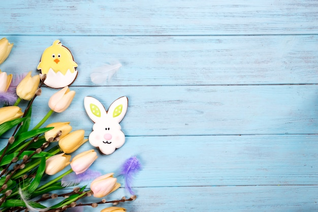 Frame of sweets for celebrate easter. gingerbread in shape of easter bunny, chicken and tulips
