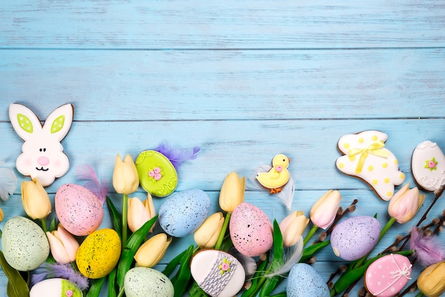 Frame of sweets for celebrate easter. gingerbread in shape of easter bunny,
