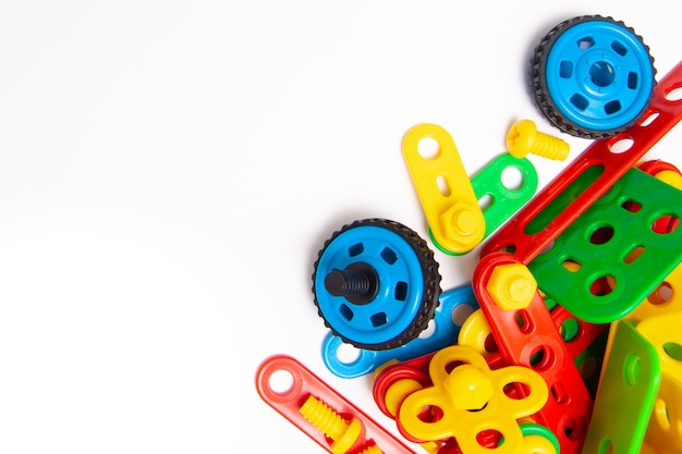 Frame for text. top view of multicolor kids toy construction blocks bricks on white background.