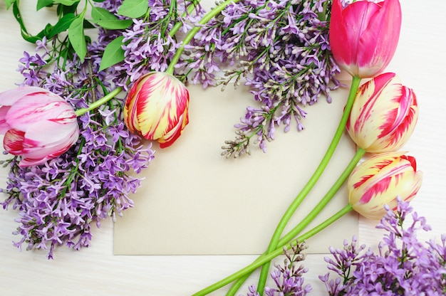 Frame of tulips and lilac copyspace. valentine dating