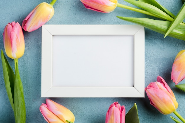Frame of tulips with white frame
