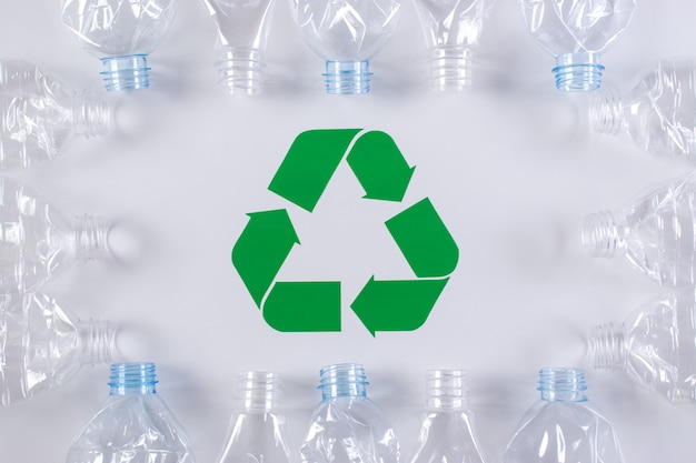 Frame of used plastic bottles background with recycle sign. recycle and world environment day concept