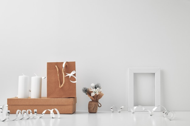 Frame, white candles and new year's decor on a white background