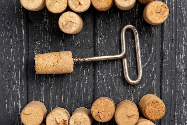 Frame of wine stoppers and corkscrew
