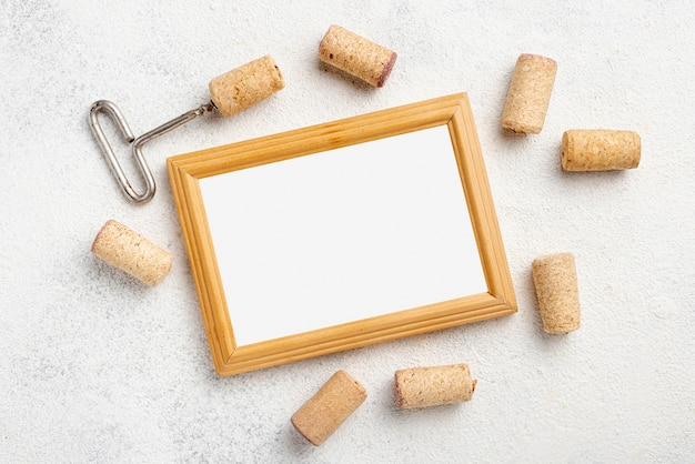 Frame and wine stoppers on table