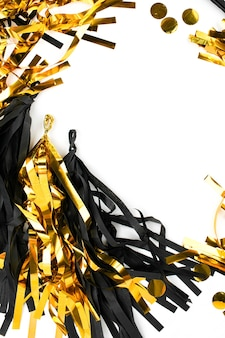 Frame with black and gold fringe tassel garland   isolated on white background. flat lay, top view.  holiday concept