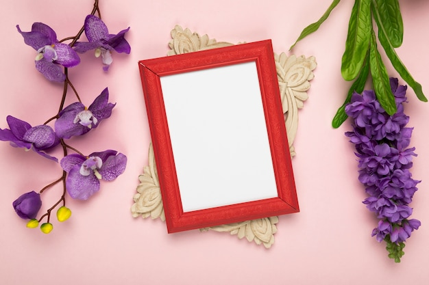 Frame with blooming flowers beside