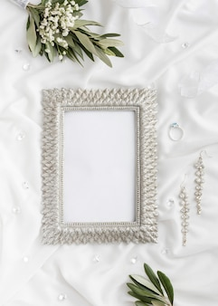 Frame with bride jewellery beside