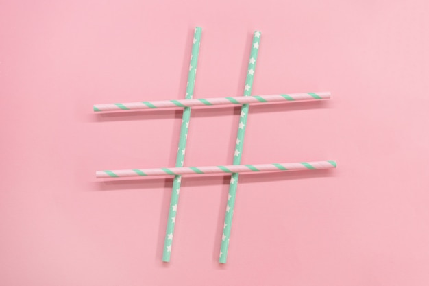Frame with colorful paper coctail tubes on the pink background. eco friendly. zero waste
