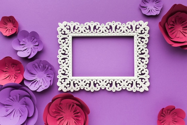 Frame with colorful paper flowers