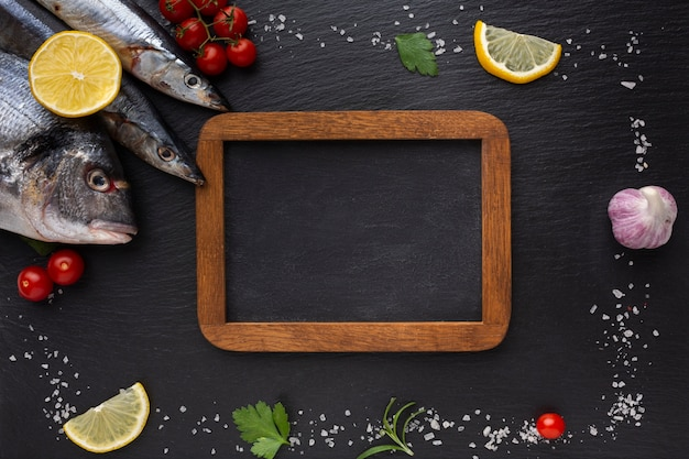 Frame with condiments and fresh fish