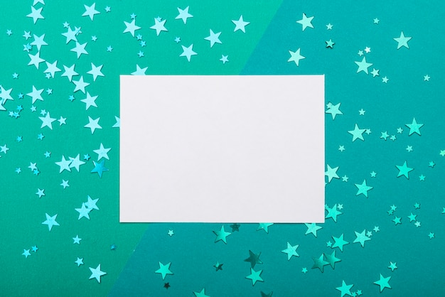 Frame with confetti stars on turquoise background