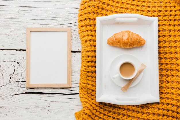 Frame with cup of coffee