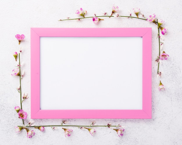 Frame with flowers beside