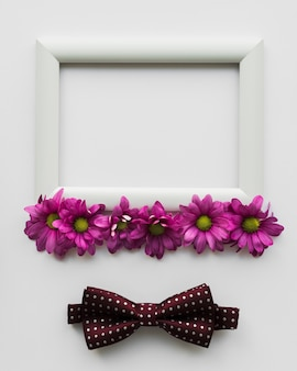 Frame with flowers and bow