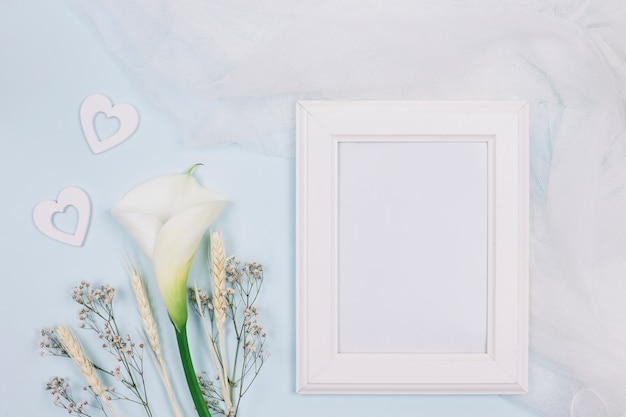 Frame with flowers and bridal veil