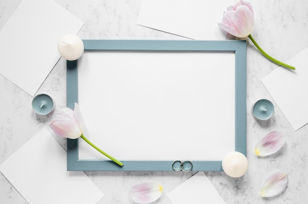 Frame with flowers and candles