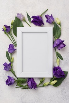 Frame with flowers on table