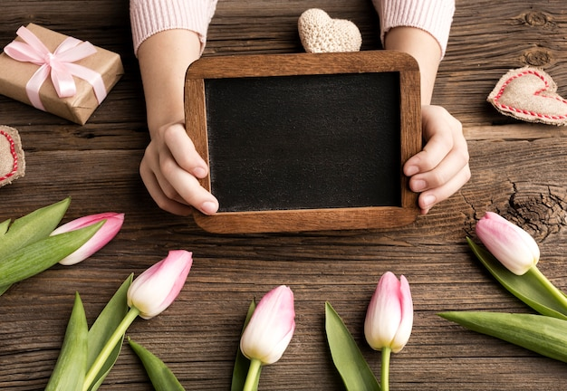 Frame with gift and tulips