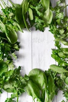 Frame with green fresh vegetables
