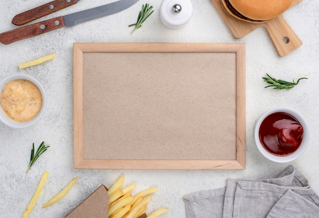 Frame with hamburger and fries