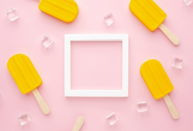 Frame with ice cubes and ice cream