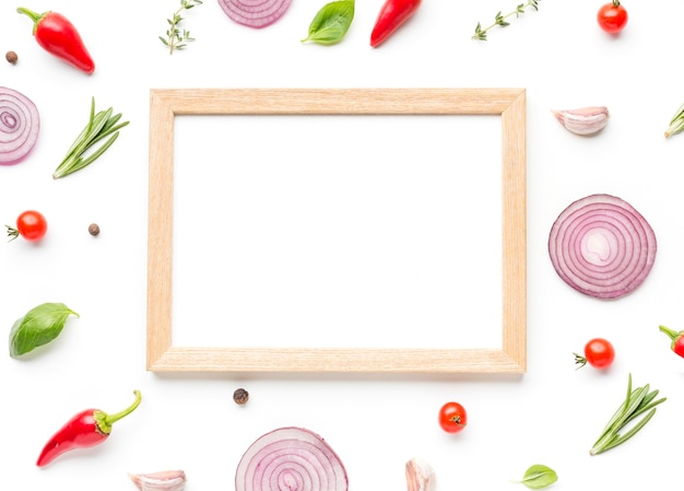 Frame with ingredients and herbs on table