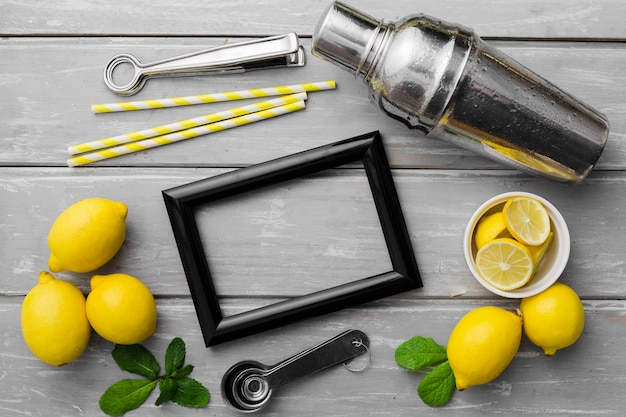 Frame with lemons and shakes