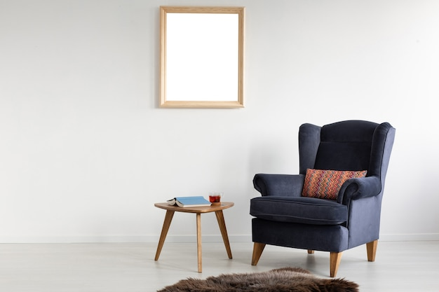Frame with mockup on white wall of elegant living room with comfortable armchair coffee table