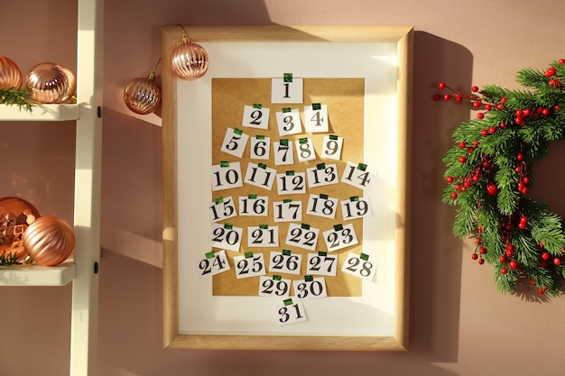 Frame with numbers hanging on wall in room. christmas celebration