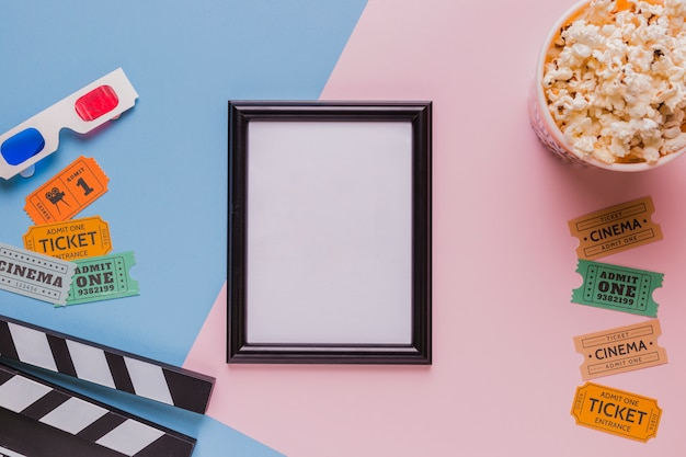 Frame with popcorns and clapperboard