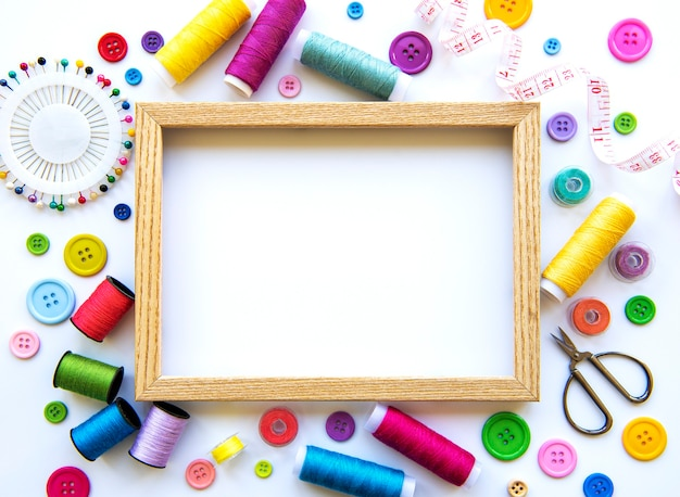 Frame with sewing tools and accessories