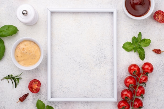 Frame with tomatoes and souce