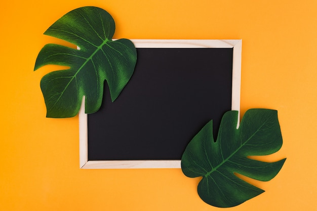 Frame with tropical leaves