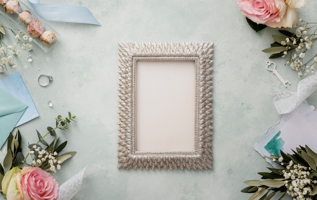 Frame with wedding decorations beside