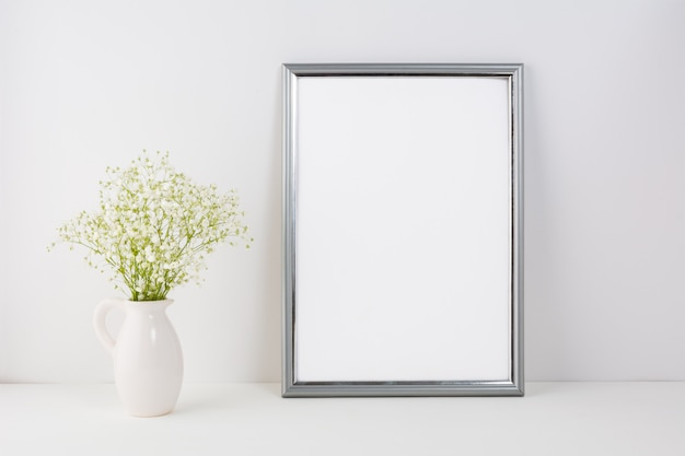 Frame  with white tender flowers