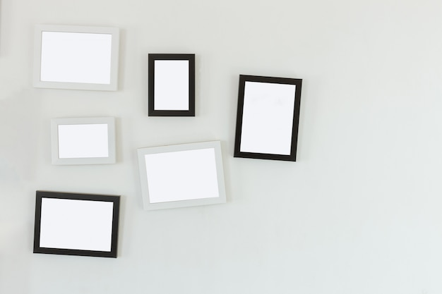 Frames hanging on white wall