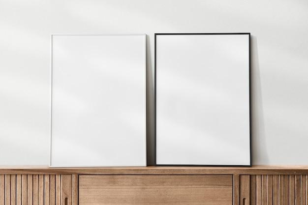 Frames mockup on wooden sideboard table