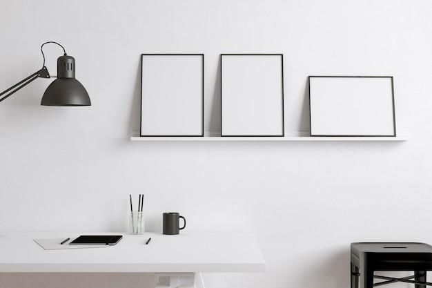 Frames on white shelf artist room concept