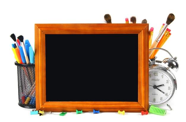 Рамки и школьные инструменты на белом фоне